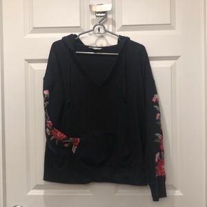 Black pullover with flower detail sleeves
